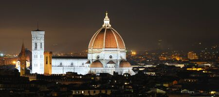 Skyline of Firenze or Florence by night with duomo prominent, Italy, Europe photo