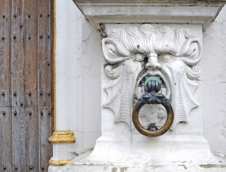 cupper: Mythical stone head as a doorknob, detail of old court of justice Brugse Vrije, Bruges