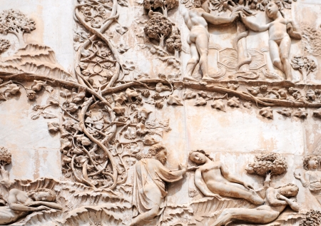 Cathedral Orvieto,  bas-reliefs garden of eden, italy photo