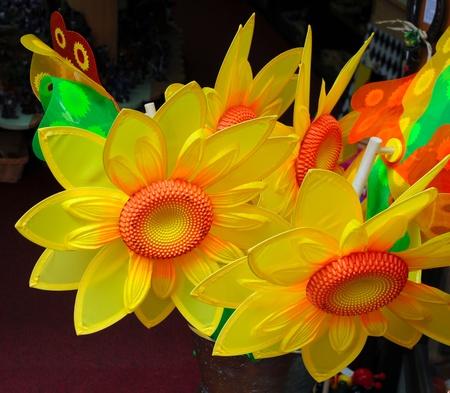 ersatz: bright yellow and orange plastic sunflowers