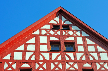 Detail of half-timbered gable in red and white in Fulda, Germany, Europe