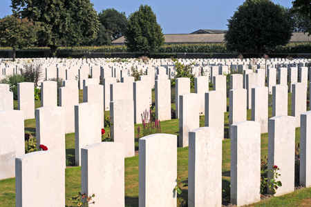 burried: British World War I cemetery in Poelkapelle near Ypres, where over 6000 unknow fallen commonwealth soldiers are burried, selective focus Stock Photo