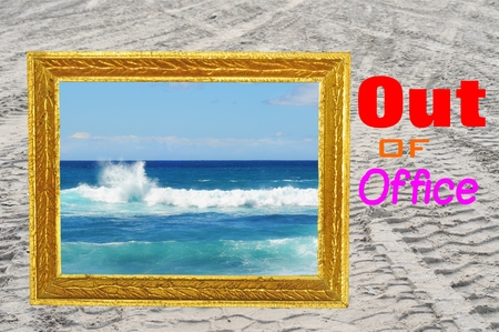 Out of office sign with vintage golden frame and ocean background photo