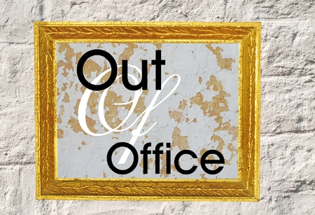 Out Of Office Sign In Black And White In Vintage Golden Frame On White  Brick Background