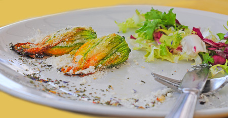 stuffed courgette flowers with fres side salad, selective focus