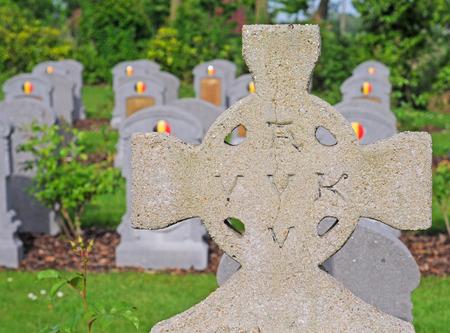 world war 1: heldenhuldezerkje with avv vvk and graves of belgian soldiers fallen in world war 1 in oeren, flanders, belgium, selective focus Editorial