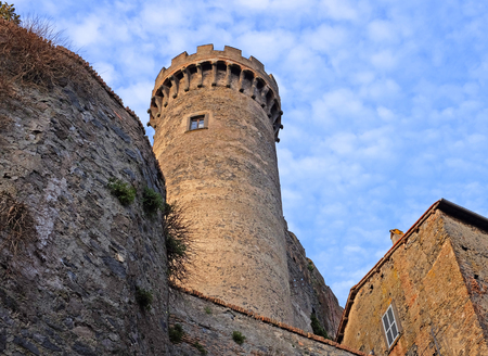 Tower of castello Odeschalchi in Bracciano with blue sky and fluffy clouds, Rome, Lazio, Italy, Europe