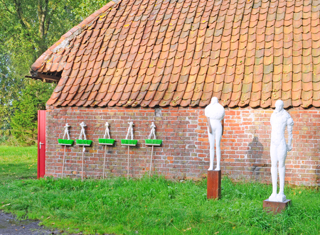 figurative: BRUGES, BELGIUM – AUGUST 27, 2014: Art by Vandewalle in the annual open air exhibition Lissewege, Sculptures in the White Village. Over 100 sculptors of contemporary art exhibit in this 20th edition