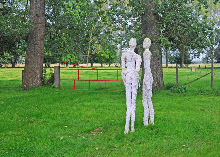 BRUGES, BELGIUM – AUGUST 27, 2014: Art by Ann Vrielinck in the annual open air exhibition Lissewege, Sculptures in the White Village. Over 100 sculptors of contemporary art exhibit in this 20th edition Editorial