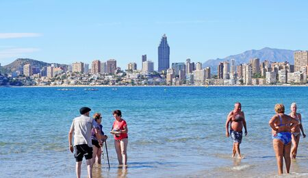 BENIDORM, SPAIN - NOVEMBER 6, 2014: Elderly people from all over Europe spend the colder season in Benidorm enjoying the sunny microclimate and the healthy seawater