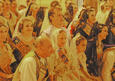 VALENCIA, SPAIN - NOVEMBER 8, 2014: evening group ceremony of Valencian falleras, inhabitants of all ages dressed in beautiful, original, handmade clothes and with typical hairstyle