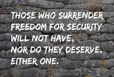 mineralized: Motivational text from Benjamin Franklin in graffiti style Those who surrender freedom for security will not have, nor do they deserve, either one, on trench from World War I, relic, fossilized sandbags