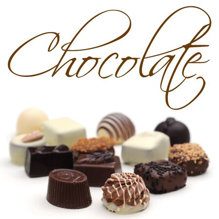 Belgian chocolates on white, shallow depth of field, easy removable sample text Stock Photo