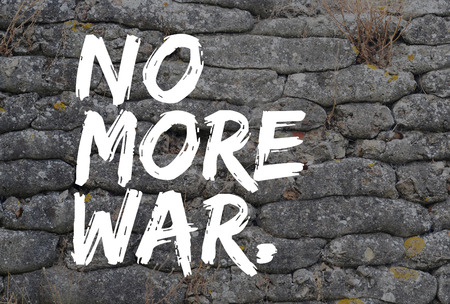 artifact: No more war, text in graffiti style on trench from World War I, relic, fossilized sandbags, background Stock Photo