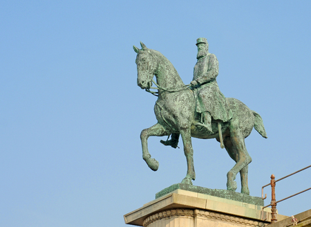 Antique bronze statue of king Leopold 2 on his horse against blue sky in Ostend, Belgium Stock Photo