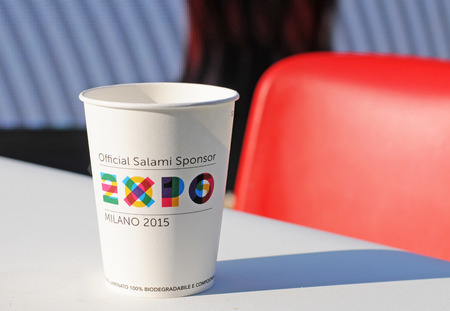 MILAN, ITALY - MAY 28, 2015: Expo 2015 feeding the planet, energy for life is attracting millions of people from the whole world till october 31. Cartboard cup with logo