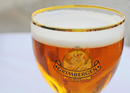 ORLEANS, FRANCE - JULY 4, 2015: The traditional Belgian blond abbey beer brand Grimbergen with the phenix logo is very popular in Orleans and other parts of France
