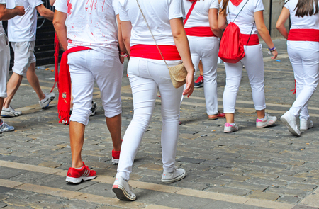 PAMPLONA, SPAIN - JULY 8, 2015: During the famous traditional annual feast of San Fermin, July 6 to 14, all inhabitants and most visitors are dressed in the city colours red and white