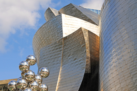 BILBAO, SPAIN - JULY 7, 2015: Part of the Guggenheim museum exterior, an iconic masterpiece of contemporary architecture designed by Frank Gehry, one of the most important modern art musea worldwide