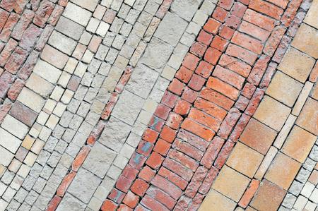 irregular diagonal brickwork pattern in different colors and shapes of bricks, background image