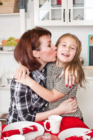 mother kisses and embraces the daughter