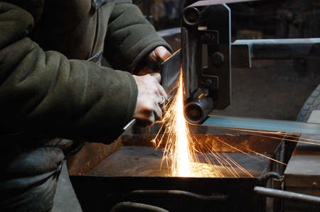 sweltering: Blacksmith turning a knife