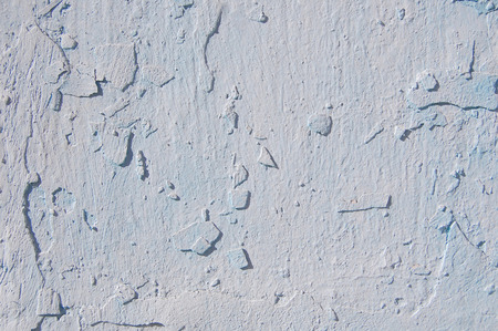 Old cracked paint pattern on concrete background. Peeling paint.