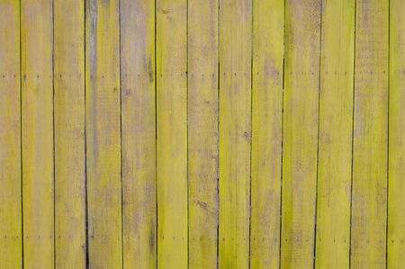 palisade: yellow wooden planks, palisade Stock Photo