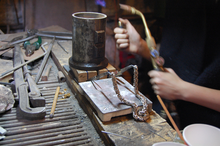 jeweller making silver chain