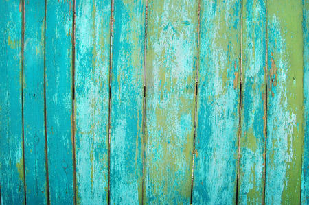 green old wooden fence. wood palisade background. planks texture. greenery Stock Photo