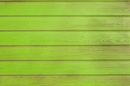 Green old wooden fence. wood palisade background. planks texture