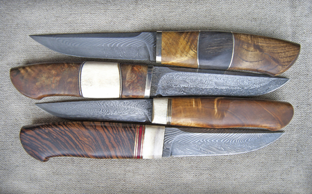 Damascus steel blade of knife. closeup of wootz, blacksmith forging process. Collection