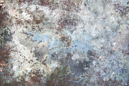 Metal background with rust and traces of paint and oxide, texture of titanium, sheet of metal surface, black and gray steel, red, blue