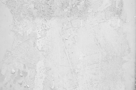 Old cracked paint pattern on rusty background. Peeling white grunge material. Damaged metal surface. Scratched plate 免版税图像