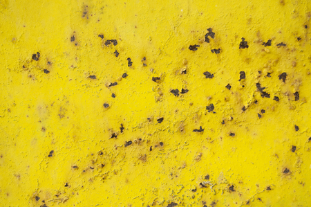 Yellow old rusty background. grunge material. Damaged metal surface. Scratched plate