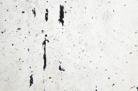 Black paint traces on white cement background