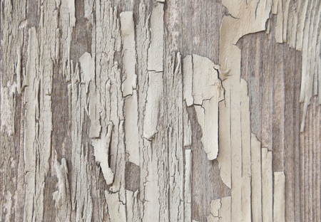 Cracked paint on a wooden wall. White color