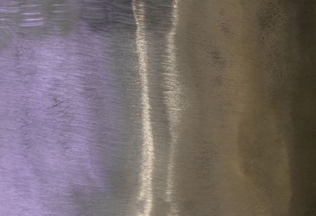 Metal background, texture of titanium, sheet of metal surface. iridescence. Heat tint, variety of colors.