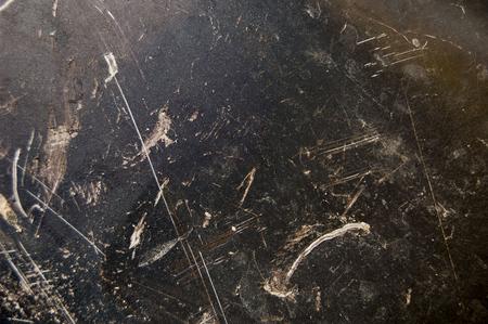 Metal background, cracked paint, sheet of black surface, grunge