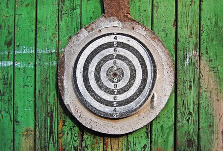 Wood planks with shooting target, green texture, wooden background, fence, green