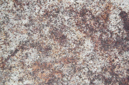Old cracked paint pattern on rusty background. Peeling grunge material. Damaged metal surface. Scratched plate