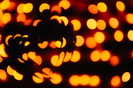 silhouette of the symbol of love - hearts against the bright orange blurred lights, valentine card