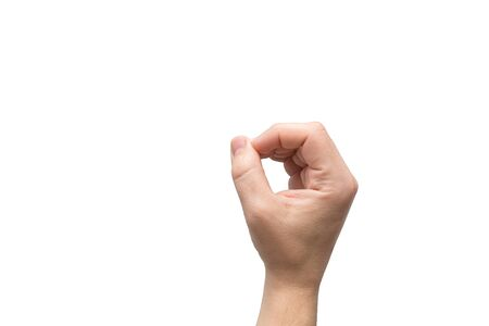 Hand isolated on white color background, number zero depicted by a hand gesture