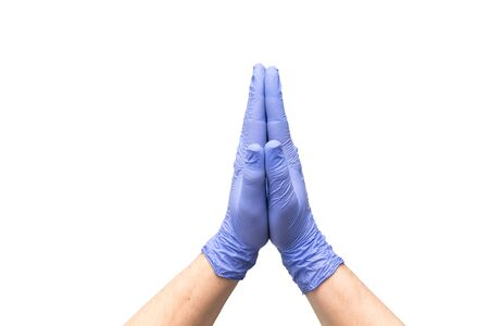 Hands in latex medical gloves folded together indicating the process of prayer. Hope cleaner for quick and easy cleaning. Palms isolated on a white background. Close-up.