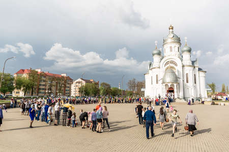Beryoza, Belarus - April 27, 2019: Believers are waiting in line to come in to church and attend the Easter service. Spring Christian holiday.