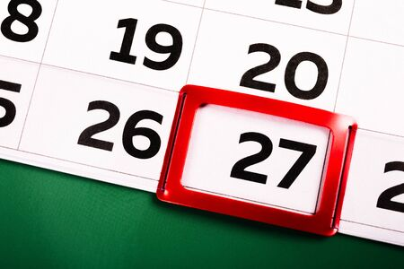 The number 27 on the calendar is highlighted in red. The twenty-seventh day of the month. Agenda for today. Close-up.