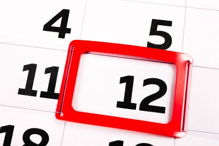 The number 12 on the calendar is highlighted in red. The twelfth day of the month. Agenda for today. Close-up.