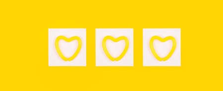 Heart in a white square on a yellow background. Layout for advertising on the topic of relationships, health, medicine, lifestyle or sports. Painting as a bright accent of the interior. Wallpaper.