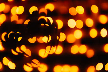 silhouette of the symbol of love - hearts against the bright orange blurred lights, valentine card Фото со стока