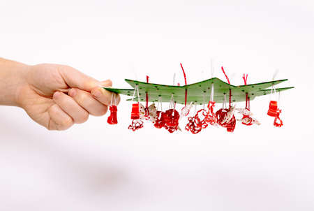Step by step instruction how to make Christmas tree. Green cardboard in the shape of star imitate a branches. Macaroni are attached by thread into the holes, fasten by drop of glue and cut the excess. Фото со стока